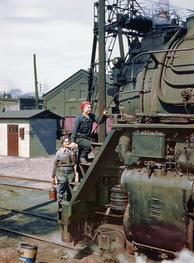 "Women wipers of the Chicago and North Western Railroad cleaning one of the giant ""H"" class locomotives, Clinton, Iowa, 1943"