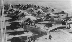 Zuikaku crewmen service aircraft on the carrier's flight deck on 5 May