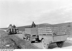 Ben Hur trailer towed by U.S. Army M3 half-track, early 1943