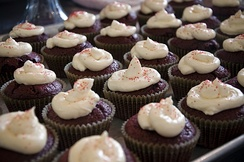 Chocolate cupcakes with cream icing and red sprinkles