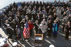Crew members and guest salute as the colors are paraded at the decommissioning ceremony of the salvage and rescue ship Grasp