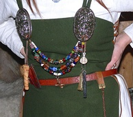 Typical jewellery worn by women of the Karls and Jarls: ornamented silver brooches, coloured glass-beads and amulets