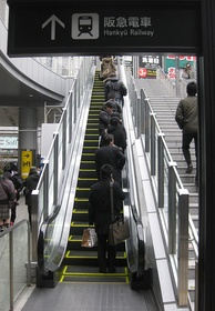 Riders stand to the right on this escalator in Umeda, Osaka, Japan