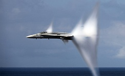 An F/A-18C Hornet in transonic flight producing flow-induced vapor cone