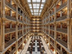 Interior of the George Peabody Library at the Peabody Institute of Johns Hopkins University. It is considered one of the most beautiful libraries in the world.[254]