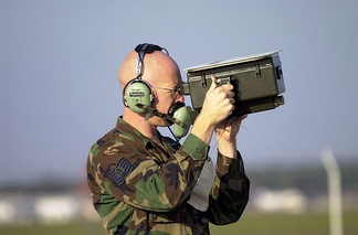 An IFF test set used by a United States Air Force avionics technician Technical Sergeant for testing transponders on aircraft