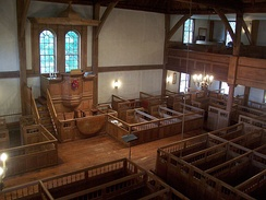 Interior of the Old Ship Church, a Puritan meetinghouse in Hingham, Massachusetts. Puritans were Calvinists, so their churches were unadorned and plain. It is the oldest building in continuous ecclesiastical use in America and today serves a Unitarian Universalist congregation.