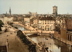 Slotsholmen canal, as seen from the Børsen building (c. 1900). In the background from left to right: Church of the Holy Ghost, Trinitatis Complex, St. Nicholas Church and Holmen Church