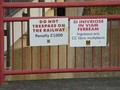 No trespassing signs with penalty, in English and Latin