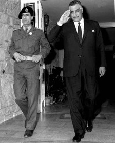 "Gaddafi (left) with Egyptian President Nasser in 1969. Nasser privately described Gaddafi as ""a nice boy, but terribly naïve"".[110]"