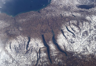 Satellite view. Lake Ontario is at top, Oneida Lake upper right, Cazenovia Lake directly below Oneida.