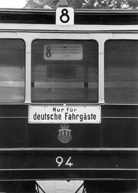 "Nur für deutsche Fahrgäste (""Only for German Passengers""), a Nazi slogan used in occupied territories, mainly posted at entrances to parks, cafes, cinemas, theatres and other facilities."