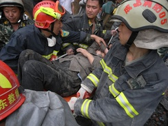 This elderly woman was rescued and placed on a stretcher after being trapped for over 50 hours.