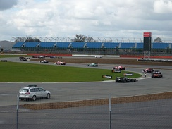 Formation lap around Brooklands corner at the 2010 Superleague Formula round