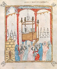 Image of a cantor reading the Passover story in Al Andalus, from the 14th century Haggadah of Barcelona.
