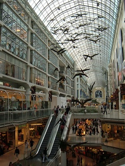 Interior of the Toronto Eaton Centre showing one of Michael Snow's best known sculptures, titled Flightstop, which depicts Canada geese in flight.