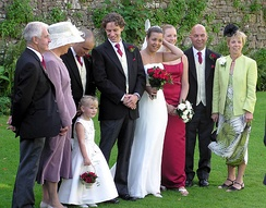 A wedding party preparing for formal photographs at Thornbury Castle