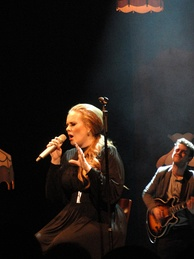 "Adele performing ""Someone like You"" in 2011 during a concert in Seattle, Washington."
