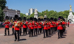 The Band of the Welsh Guards of the British Army play as Grenadier guardsmen march from Buckingham Palace to Wellington Barracks after the Changing Of The Guard.