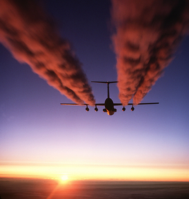 A C-141 Starlifter leaves contrails over Antarctica.