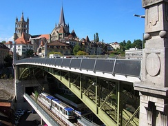 The Charles-Bessières bridge with Lausanne Metro car. In the background the cathedral of Notre-Dame and the old town.