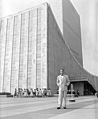 UN Secretary General Dag Hammarskjöld in front of the United Nations Headquarters building, completed in 1952