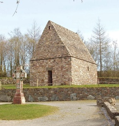 A reconstruction of an early Irish Christian chapel and high cross