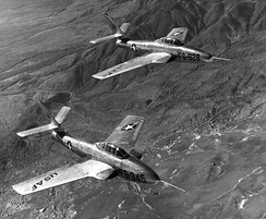 YF-84F and YRF-84F prototypes in 1952. Note the early style wing root jet intakes, which were eventually only retained on the RF-84F, due to the need to fit cameras in the nose. The standard F-84F reverted to the original nose intake due to a loss of thrust from the wing root intakes.