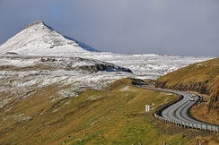The road network on the Faroe Islands is highly developed. Shown here is the road from Skipanes to Syðrugøta on the island of Eysturoy.