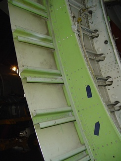 Sectioned fuselage showing frames, stringers and skin all made of aluminium