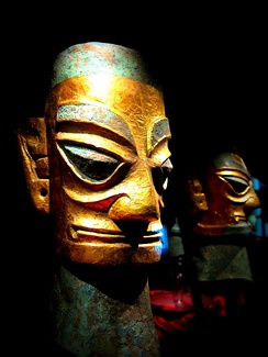 Two bronze heads from Sanxingdui, covered with gold leafs