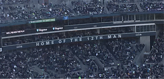 """Home of the 12th Man"" signage within CenturyLink Field in 2013."