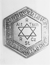 Metal badge of a Jewish policeman in the Czestochowa ghetto.