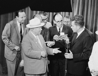 Soviet First Secretary Nikita Khrushchev and United States Vice President Richard Nixon debate the merits of communism versus capitalism in a model American kitchen at the American National Exhibition in Moscow (July 1959) – photo by Thomas J. O'Halloran, Library of Congress collection