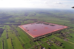 """Bauxite tailings"" storage facility in Stade, Germany. The aluminium industry generates about 70 million tons of this waste annually."