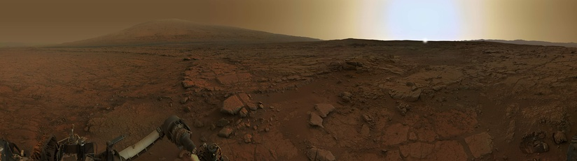 Panorama of rocks near the Curiosity Rover – at Yellowknife Bay around sunset (February 2013; Sun simulated by artist).