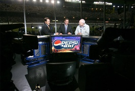Chris Myers (left) and Jeff Hammond (center) appear on the studio set alongside Vice President of the United States Dick Cheney (right) during the 2006 Pepsi 400.