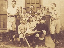 Stephen Crane (front row, left) sits with baseball teammates on the steps of the Hall of Languages, Syracuse University, 1891. (Photo courtesy of the SU Special Collections Research Center)