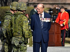 Prince Philip, Duke of Edinburgh, wearing at the neck the insignia of a Companion of the Order of Canada. Philip originally declined an honorary appointment to the Order of Canada, feeling the offer implied he was a foreigner to Canada. In April 2013, he accepted appointment as the first extraordinary Companion.