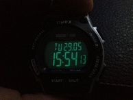 Digital LCD wristwatch Timex Ironman with electroluminescent backlighting.