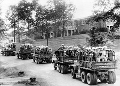 U.S. Army trucks loaded with Federal law enforcement personnel on the University of Mississippi campus 1962