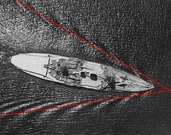 Aerial view of the German battleship Schlesien, showing a 39° wake, characteristic of vessels passing through water.