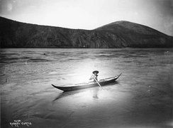 Chief Isaac of the Han in a canoe, 1898
