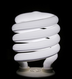 A compact fluorescent bulb is a household application of a gas-filled tube