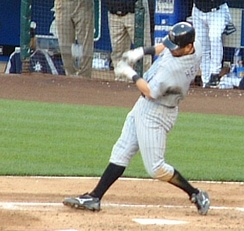Helton swinging at a pitch during a game against the Seattle Mariners.