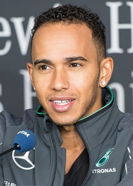 A picture of Lewis Hamilton donning Mercedes Grand Prix attire.
