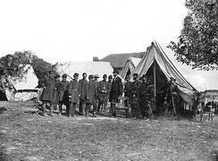 Lincoln with McClellan and staff at the Grove Farm after the battle. Notable figures (from left) are 1. Col. Delos Sackett; 4. Gen. George W. Morell; 5. Alexander S. Webb, Chief of Staff, V Corps; 6. McClellan;. 8. Dr. Jonathan Letterman; 10. Lincoln; 11. Henry J. Hunt; 12. Fitz John Porter; 15. Andrew A. Humphreys; 16. Capt. George Armstrong Custer.