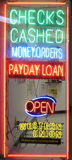 A shop window in Falls Church, Virginia, advertises payday loans