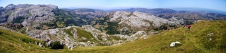 Panorama of the Cantabrian Mountains to the left and the port city of Santander in the distant right. The peak Alto de Brenas in Riotuerto has a height of 579 metres.