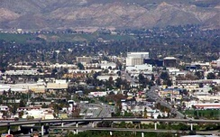 San Bernardino with downtown in the background and the I-215 freeway in the foreground.
